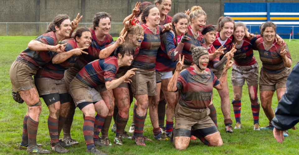 Clontarf Women's Rugby Team photo with muddy players