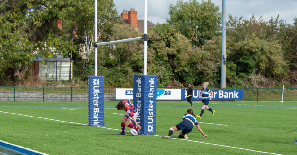 Clontarf Women's Rugby player scoring a try