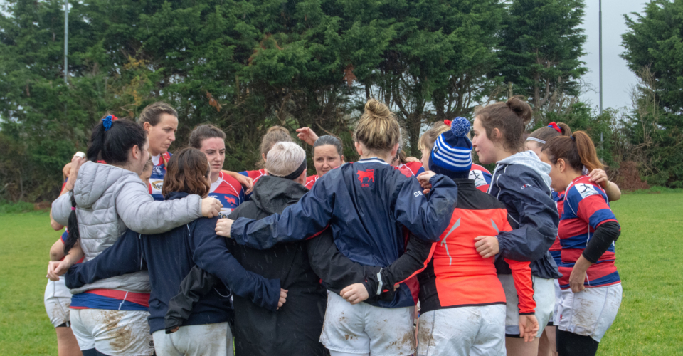 Clontarf Women's Rugby team Group huddle