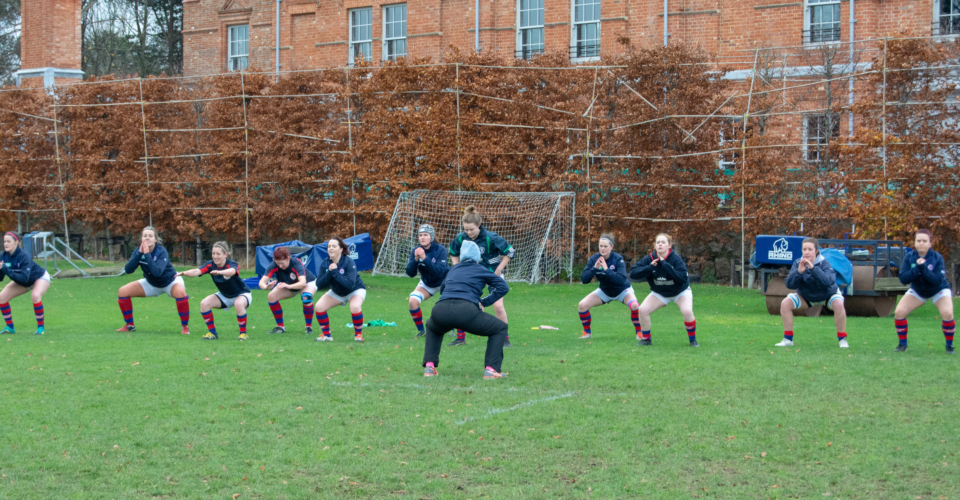 Clontarf Women's Rugby team warming up before a match with S&C Coach