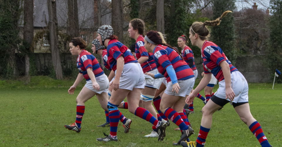 Clontarf Women's Rugby team running